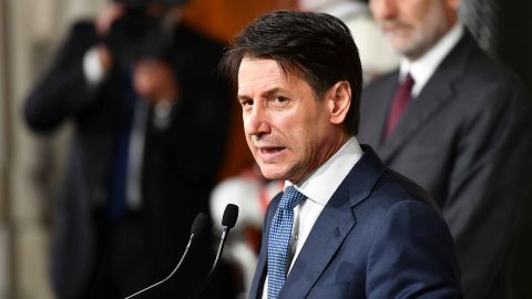 Italian lawyer Giuseppe Conte addresses journalists after a meeting with Italy's President Sergio Mattarella on May 23, 2018 at the Quirinale presidential palace in Rome. Italy's president approved little-known lawyer Giuseppe Conte's nomination to be prime minister of a government formed by far-right and anti-establishment parties. (Photo by Vincenzo PINTO / AFP)        (Photo credit should read VINCENZO PINTO/AFP/Getty Images)