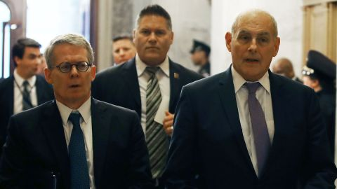 """WASHINGTON, DC - MAY 24:  White House Chief of Staff John Kelly (R) and White House lawyer Emmet Flood (L) arrive to attend a briefing with members of the so-called 'Gang of Eight' at the U.S. Capitol May 24, 2018 in Washington, DC. The bipartisan group of senators requested a briefing from Coats, Federal Bureau of Investigation Director Christopher Wray and other intelligence officials about the FBI's use of a confidential intelligence source in the Russia investigation. The """"Gang of Eight"""" consists of the top Republican and Democratic members of the House and Senate intelligence committee as well as congressional leaders from both parties.  (Photo by Mark Wilson/Getty Images)"""