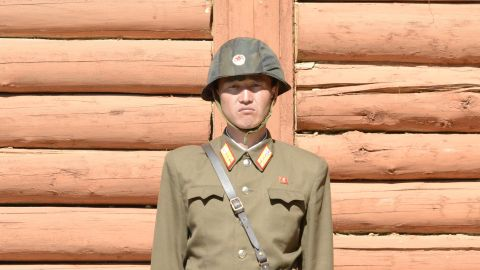 A close-up of a soldier standing guard in front of an observation building at tunnel 2.