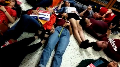 """NS Slug: FL: PUBLIX DIE-IN HELD AGAINST CANDIDATE ADAM PUTNAM  Synopsis: Footage of several Marjory Stoneman Douglas students participating in a protest at a Coral Springs, FL Publix  Video Shows: - Footage of several Marjory Stoneman Douglas students participating in a protest at a Coral Springs, FL Publix by drawing chalk outlines in the parking lot and lied down for exactly 12 minutes in the store. - MSD student David Hogg called for a boycott of Publix due to them donating to gubernatorial candidate Adam Putnam, who has an """"A"""" rating from the NRA.   Keywords: FLORIDA PUBLIX PROTEST NRA GUN SUPPORT"""