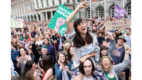 """A woman from the """"Yes"""" campaign reacts after final results were announced Saturday at Dublin Castle."""
