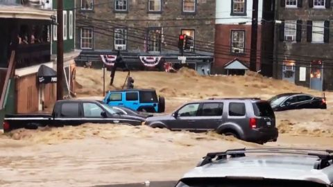 Water rushes through Main Street in Ellicott City, Md., Sunday, May 27, 2018. After the floodwaters receded, emergency officials had no immediate reports of fatalities or injuries. But by nightfall first responders and rescue officials were still going through the muddied, damaged downtown, conducting safety checks and ensuring people evacuated. (Libby Solomon/The Baltimore Sun via AP)