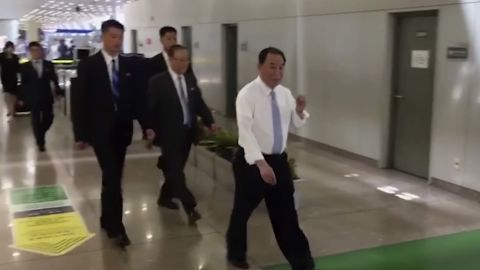 In this image made from video, Kim Yong Chol, in white, a former military intelligence chief who is now Kim Jong Un's top official on inter-Korean relations, walks upon arrival at Beijing airport in Beijing Tuesday, May 29, 2018. He was at North Korean leader Kim Jong Un's side at the table in last weekend's North-South summit, and had been a prominent senior official in other important talks. It was not possible to confirm the reason for his visit to Beijing, or if he would be traveling on to another destination. (AP Photo)