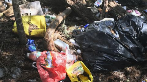 This photo provided by the US Attorney's Office shows trash found at an illegal marijuana site near Hayfork, California.