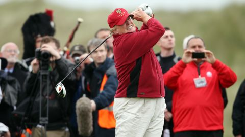 ABERDEEN, SCOTLAND - JULY 10:  Donald Trump opens The Trump International Golf Links Course in Balmedie by hitting the first ball down the first fairway on July 10, 2012 in Balmedie, Scotland. The controversial £100m course opens to the public on Sunday July 15. Further plans to build hotels and homes on the site have been put on hold until a decision has been made on the building of an offshore windfarm nearby. (Photo by Ian MacNicol/Getty Images)