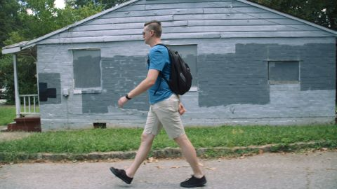 Costello walks through his neighborhood on his way to a class at Georgia State University College of Law