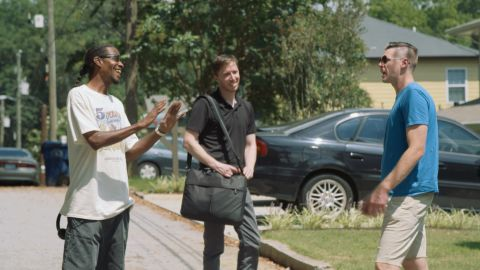 Costello talks to Calvin Dorsey and Danny Walls outside his house