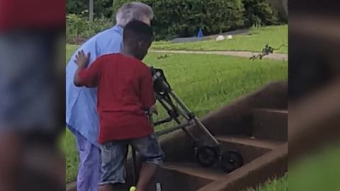 8 year old boy act of kindness elderly woman stairs_00000000.jpg