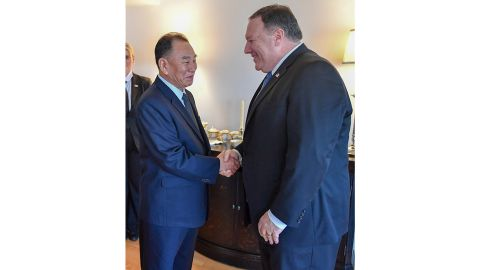 North Korean diplomat Kim Yong Chol shakes hands with US Secretary of State Mike Pompeo.