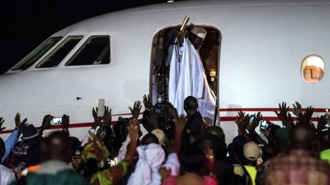 Ex-President Yahyah Jammeh waves to a crowd of supporters before leaving the country on January 21, 2017 at Banjul International Airport. Jammeh was defeated by the current president, Adama Barrow, ending his 22 year rule.