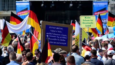 """At an AfD rally on May 27,  supporters hold placards reading """"No Islam in Germany."""""""