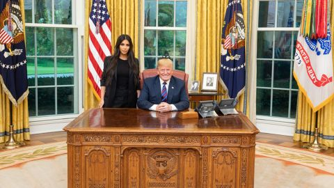 Kim Kardshian West poses for a photo with President Trump in May 2018.