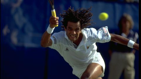 SEP 1989:  YANNICK NOAH OF FRANCE PERFORMS A RUNNING FOREHAND DURING A MATCH AT THE 1989 US OPEN PLAYED AT FLUSHING MEADOWS IN NEW YORK.
