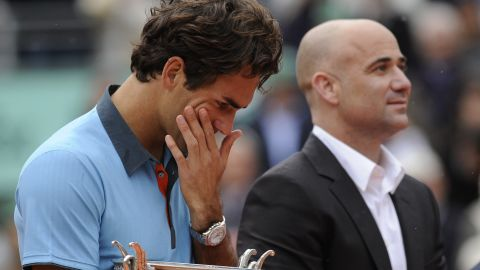 """One of Dubreuil's favorite photos is of a tearful Roger Federer, as he held the trophy after winning his only French Open title. """"I remember that final with Roger Federer against Robin Soderling,"""" she recalls. """"It was very emotional, it was raining and Andre Agassi was there to give him the trophy. I remember the picture of Roger, he was standing in the rain with the trophy and then, when the Swiss anthem was playing, he started to cry. He was like a kid."""""""