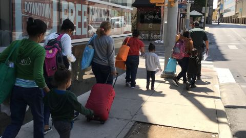 Undocumented women and their children being released from ICE custody walk to a bus station in San Antonio to continue their journey.  Source: CNN/Angela Barajas