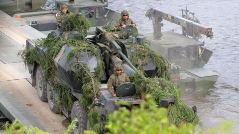 """NATO advance force battalion group (EFP) demonstrates a water obstacle crossing during an International exercise """"Iron Wolf 2017 /Saber Strike 2017' in Stasenai on June 20, 2017.   The multinational Exercise Iron Wolf 2017 as part of the Exercise Saber Strike 2017 is running in Lithuania on June 12-23 and involves over 5 thousand troops from 10 NATO allies. / AFP PHOTO / Petras Malukas        (Photo credit should read PETRAS MALUKAS/AFP/Getty Images)"""