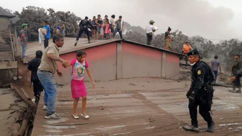 Rescue workers evacuate a house in Acatenango on June 3.