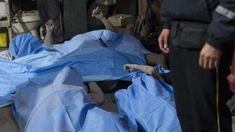 Bodies are laid in a temporary morgue in Alotenango.