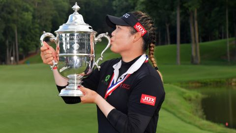 Jutanugarn kisses the US Women's Open trophy after surviving one of the scares of her career.
