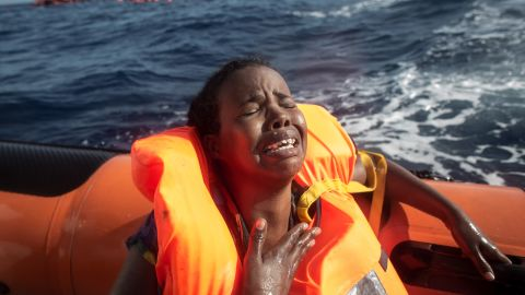 A refugee cries after losing her baby in the water off the Italian coast in May.