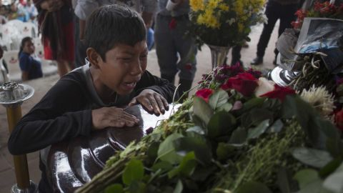 A young mourner cries over the coffin of 17-year-old Nery Otoniel Gomez Rivas, whose body was pulled from volcanic ash in Alotenango.