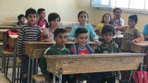 Students return to school in Raqqa, Syria.