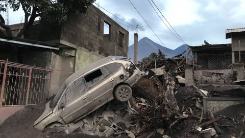 An abandoned car rests atop debris Wednesday in El Rodeo, Guatemala, after the volcano's eruption.