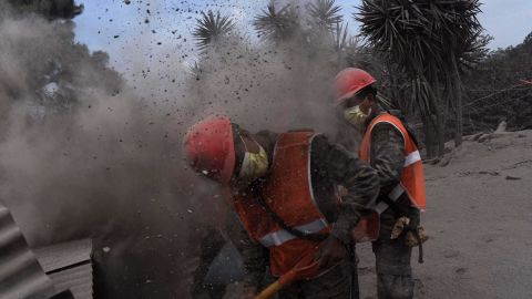 Members of the Guatemalan Army search for volcano victims in the ash-covered village of San Miguel Los Lotes.