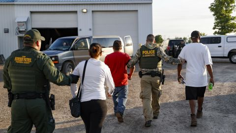Government agents take suspects into custody during Tuesday's sting in Castalia, Ohio.