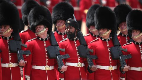 Sikh Guardsman Charanpreet Singh Lall wears a turban in Saturday's Trooping the Colour ceremony.
