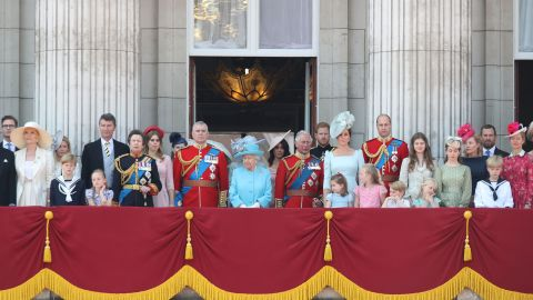 Members of Britain's royal family appear Saturday on the balcony of Buckingham Palace.