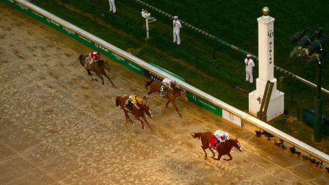 Justify, the No. 7 horse, crosses the finish line with jockey Mike Smith to win the 144th running of the Kentucky Derby at Churchill Downs on May 5, 2018, in Louisville, Kentucky.