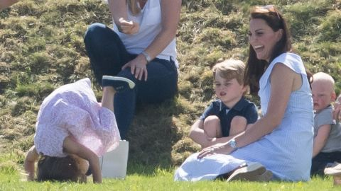 Catherine, Duchess of Cambridge, Prince George of Cambridge and Princess Charlotte of Cambridge attend the Maserati Royal Charity Polo Trophy.