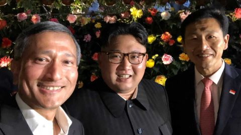 """Singapore's Minister for Foreign Affairs Vivian Balakrishnan shared this photo of himself with North Korean leader Kim Jong Un, center, and Ong Ye Kung, Singapore's Minister for Education. The tweet reads, """"#Jalanjalan #guesswhwere?""""  """"Jalan-jalan"""" means """"taking a walk"""" in Malay."""