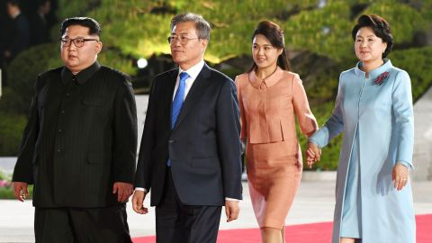 North Korea's leader Kim Jong Un and his wife Ri Sol Ju walk with South Korea's President Moon Jae-in and his wife Kim Jung-sook after their meeting in April.