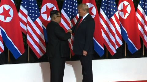 Trump Kim Jong UN shake 2