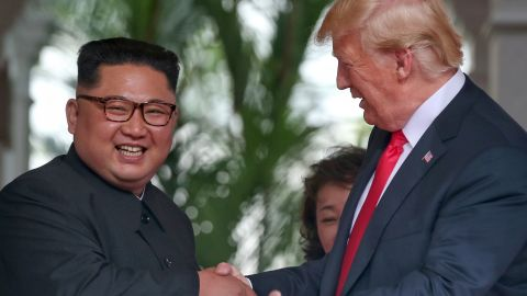 SINGAPORE - JUNE 12: In this handout photo, North Korean leader Kim Jong-un shakes hands with U.S. President Donald Trump during their historic U.S.-DPRK summit at the Capella Hotel on Sentosa island on June 12, 2018 in Singapore. U.S. President Trump and North Korean leader Kim Jong-un held the historic meeting between leaders of both countries on Tuesday morning in Singapore, carrying hopes to end decades of hostility and the threat of North Korea's nuclear program. (Photo by Kevin Lim/THE STRAITS TIMES/Handout/Getty Images)