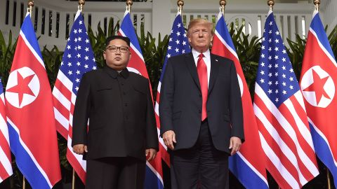 TOPSHOT - US President Donald Trump (R) poses with North Korea's leader Kim Jong Un (L) at the start of their historic US-North Korea summit, at the Capella Hotel on Sentosa island in Singapore on June 12, 2018. - Donald Trump and Kim Jong Un have become on June 12 the first sitting US and North Korean leaders to meet, shake hands and negotiate to end a decades-old nuclear stand-off. (Photo by SAUL LOEB / AFP)        (Photo credit should read SAUL LOEB/AFP/Getty Images)