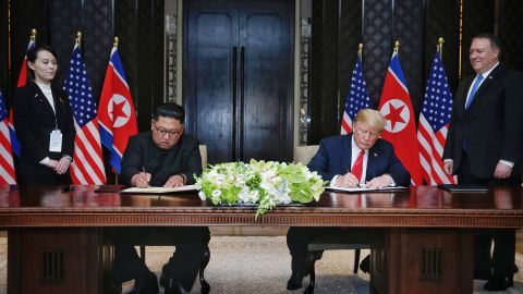 SINGAPORE, SINGAPORE - JUNE 12:  In this handout photograph provided by The Strait Times, North Korean leader Kim Jong-un (L) with U.S. President Donald Trump (R) during their historic U.S.-DPRK summit at the Capella Hotel on Sentosa island on June 12, 2018 in Singapore. U.S. President Trump and North Korean leader Kim Jong-un held the historic meeting between leaders of both countries on Tuesday morning in Singapore, carrying hopes to end decades of hostility and the threat of North Korea's nuclear programme. (Photo by Kevin Lim/The Strait Times/Handout/Getty Images)