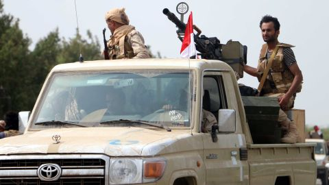 epa06803021 Yemeni forces backed by the Saudi-led coalition gather near the outskirts of the western port city of Hodeidah, Yemen, 12 June 2018. According to reports, the Saudi-led military coalition and Yemeni government forces continue to send reinforcements toward the port city of Hodeidah, preparing to launch an assault on the Houthis-controlled main port of Yemen.  EPA-EFE/NAJEEB ALMAHBOOBI