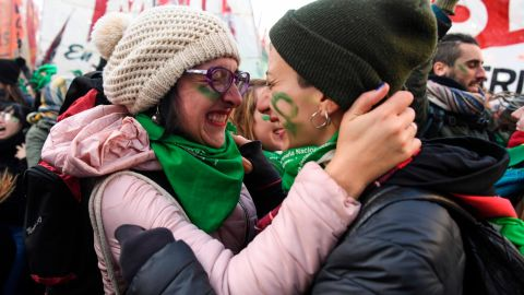 Supporters of legalized abortion embrace Thursday after the the vote in the Chamber of Deputies.