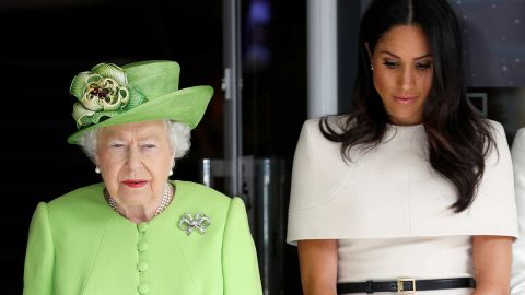 Queen Elizabeth and the Duchess of Sussex observe a moment of silence in memory of the victims.