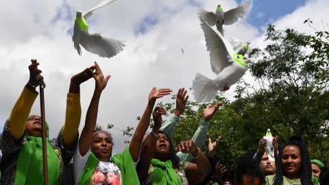 Members of the public release doves as part of commemorations on the anniversary of the fire.