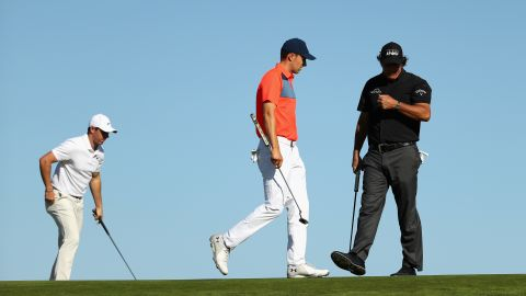 Rory McIlroy (left), Jordan Spieth (center) and Phil Mickelson formed a big-name trio on Thursday morning but the supergroup couldn't hit the right notes.