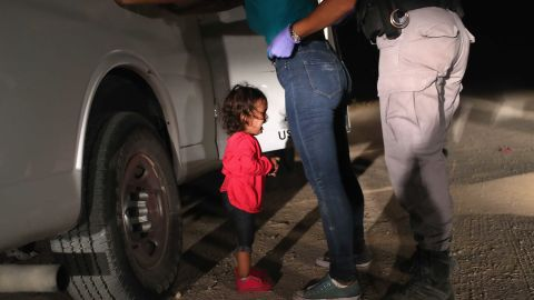 """A two-year-old Honduran asylum seeker cries as her mother is searched and detained near the U.S.-Mexico border on June 12, 2018 in McAllen, Texas. The asylum seekers had rafted across the Rio Grande from Mexico and were detained by U.S. Border Patrol agents before being sent to a processing center for possible separation. Customs and Border Protection (CBP) is executing the Trump administration's """"zero tolerance"""" policy towards undocumented immigrants. U.S. Attorney General Jeff Sessions also said that domestic and gang violence in immigrants' country of origin would no longer qualify them for political asylum status.  (Photo by John Moore/Getty Images)"""