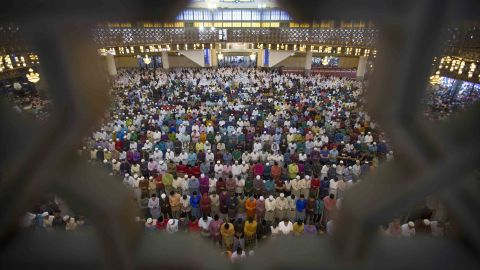 Muslims in Kuala Lumpur, Malaysia, offer prayers during the first day of Eid al-Fitr on Friday, June 15.