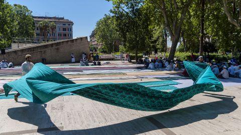 Migrants attend prayers in Rome's Piazza Vittorio Square.