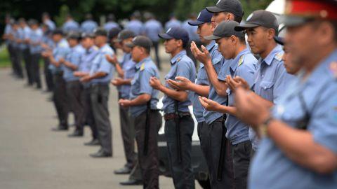 Police officers pray in Bishkek, Kyrgyzstan.
