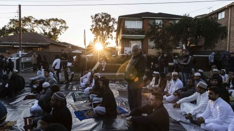A crowd gathers to pray outside the Lakemba Mosque in Sydney.