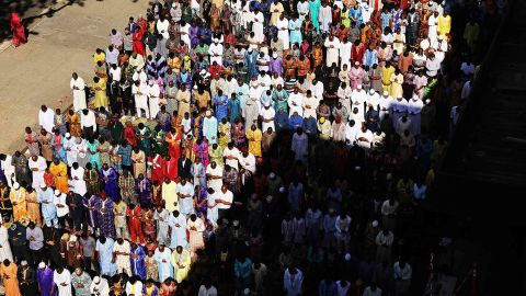 Muslims participate in an outdoor prayer event at the Masjid Aqsa-Salam mosque, Manhattan's oldest West African mosque.